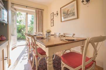 The main dining-table has seating for six. with additional seating in the breakfast-room.
