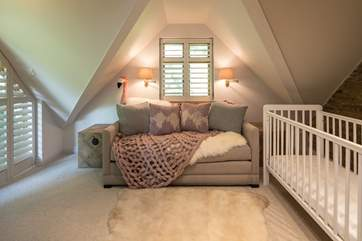 The snug, also known as bedroom 4, has a fixed cot, and on request the sofa can also double as an alternative sleeping facility (as it converts into a super comfy double bed).