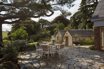 The patio-area is slightly shaded, providing the perfect place to spark up the barbecue and dine al fresco in this superb spot.