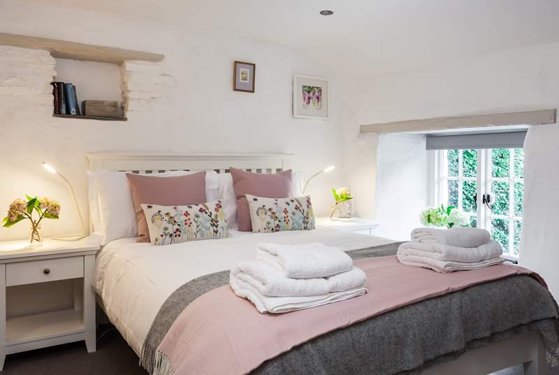 The super comfy double bedroom overlooks the pretty garden.