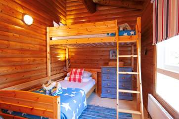Any child will love the charm and sense of adventure in this twin bedroom.