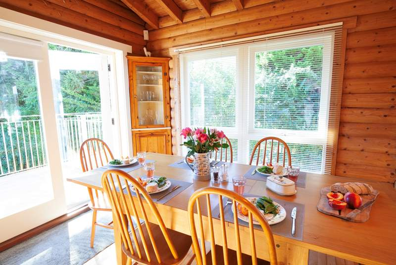 The open plan sitting/dining-room with doors leading out to the balcony - the perfect place for a family gathering.