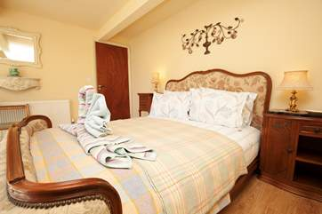 This double bedroom is located on the lower ground floor with doors leading out to the garden.