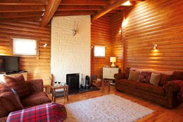 The very cosy sitting-room with multi-burner and Sony system for CDs, streaming and docking.