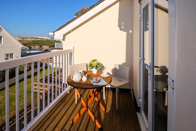 The balcony, which overlooks neighbouring houses, is a lovely spot to enjoy a morning coffee and even has a view of Porth beach in the distance.