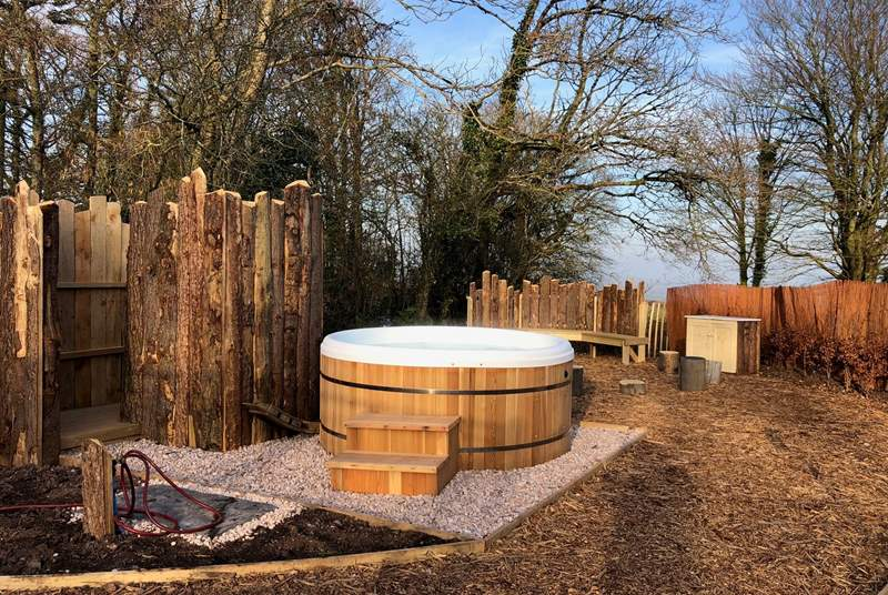 The cleverly designed space around the hot tub makes it the perfect area to gather and enjoy the stunning rolling countryside views.