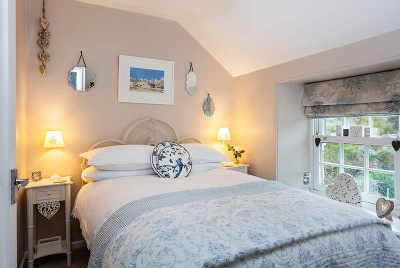 Luxurious bedding and a high finish in the master bedroom.