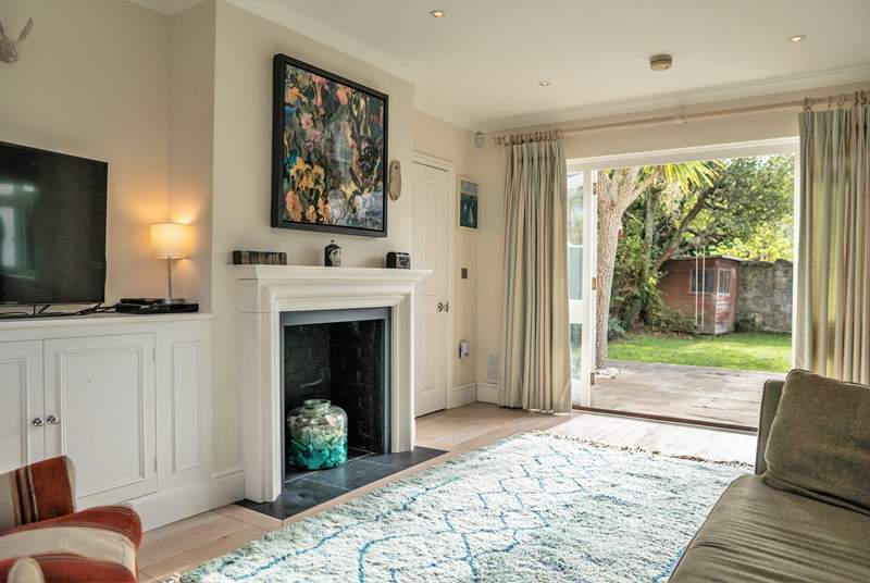 The sitting-room has doors that open up to the enclosed garden.