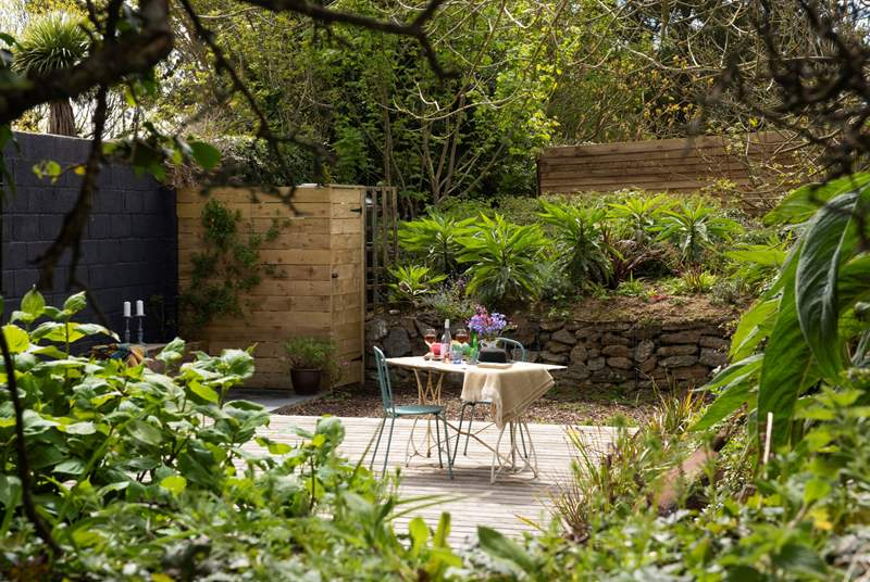 Complete with its very own enclosed garden - perfect for your four-legged friend.