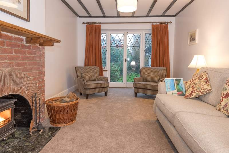 The doors from the sitting-room lead out into the large enclosed garden with outdoor seating, a place everyone can enjoy