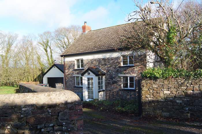 Cottages near Halsdon Woods and Nature Reserve