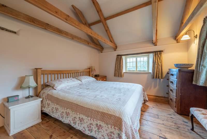 The master bedroom has original oak beams.