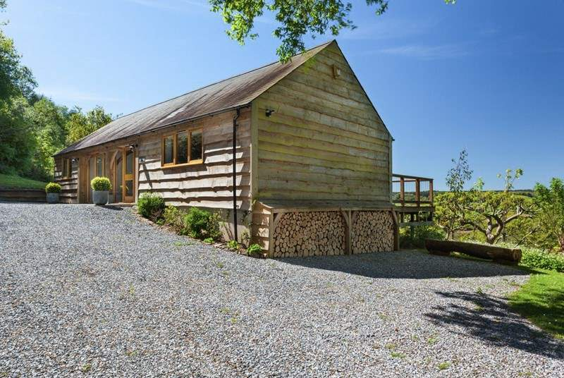 Larch Barn is detached with plenty of space for parking.