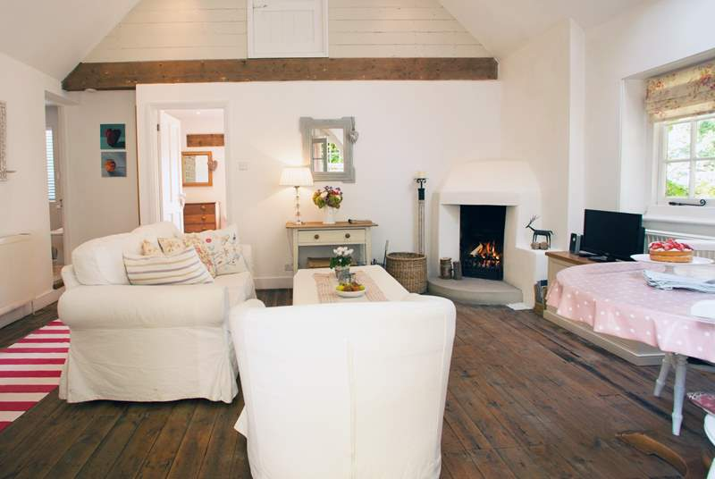 The sitting-room with dining-area has wonderful vaulted ceilings.