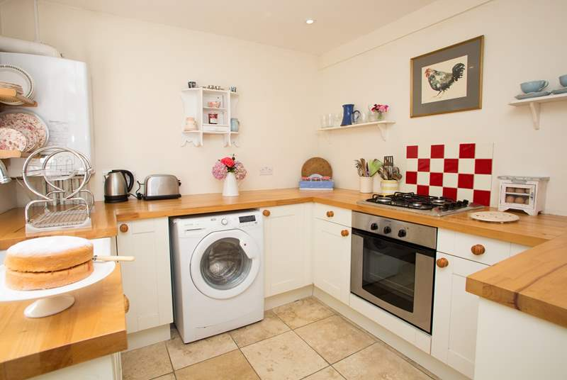 The stylish kitchen is very well-equipped....