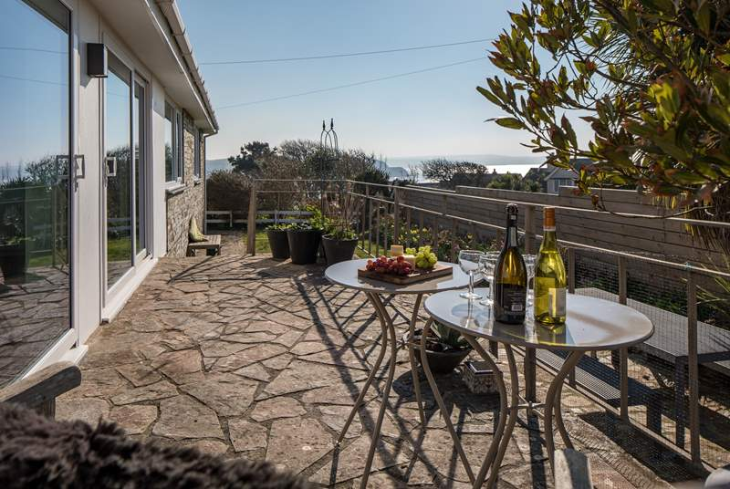 Imagine sitting back with a glass of something tasty enjoying the far-reaching sea views.