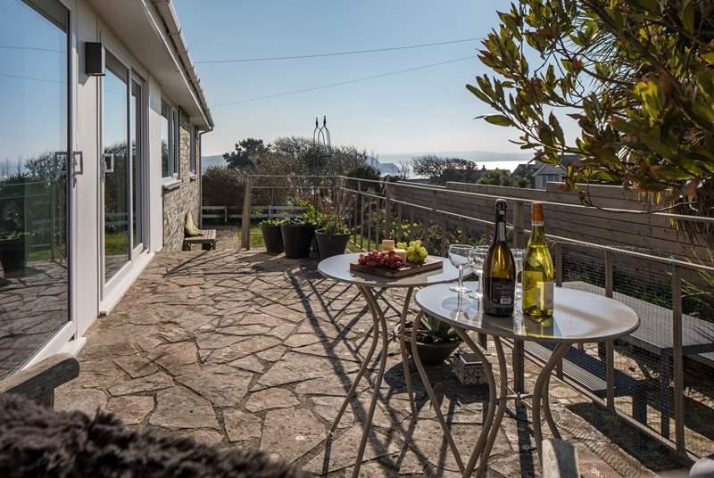 Imagine sitting back with a glass of something tasty enjoying the far-reaching sea views.