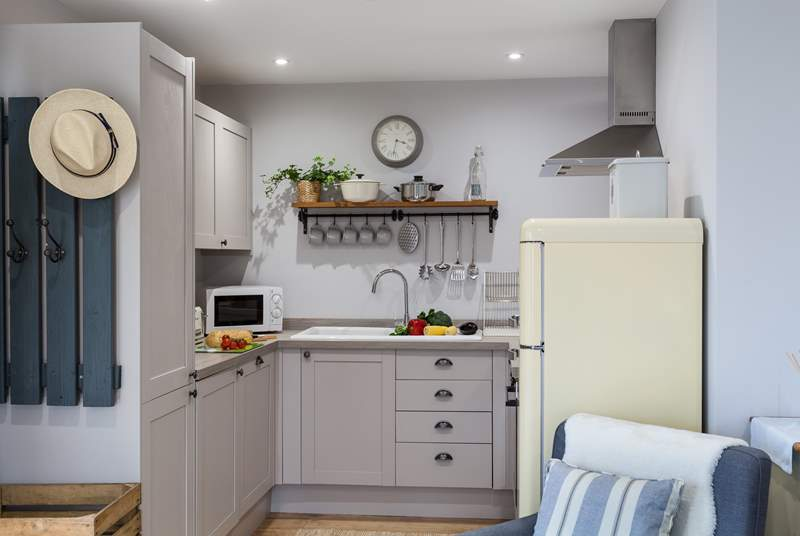 The well-equipped Shaker-style kitchen has everything you need to cook a wonderful meal whilst you are on holiday.