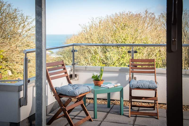 The balcony has far reaching sea views. Sit out here and enjoy a morning coffee.