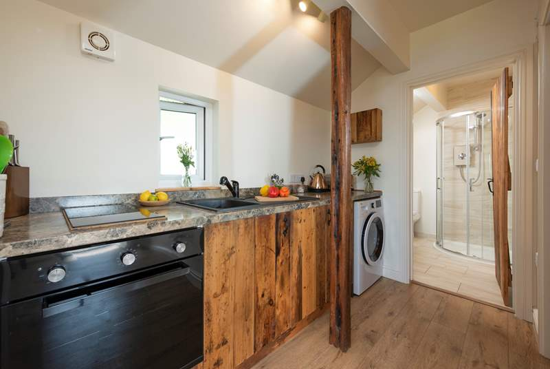 The small kitchen has been thoughtfully designed.