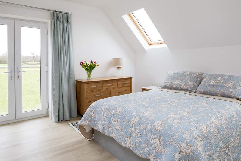 Bedroom 2 on the first floor has a king-size bed, en suite bathroom and lovely views