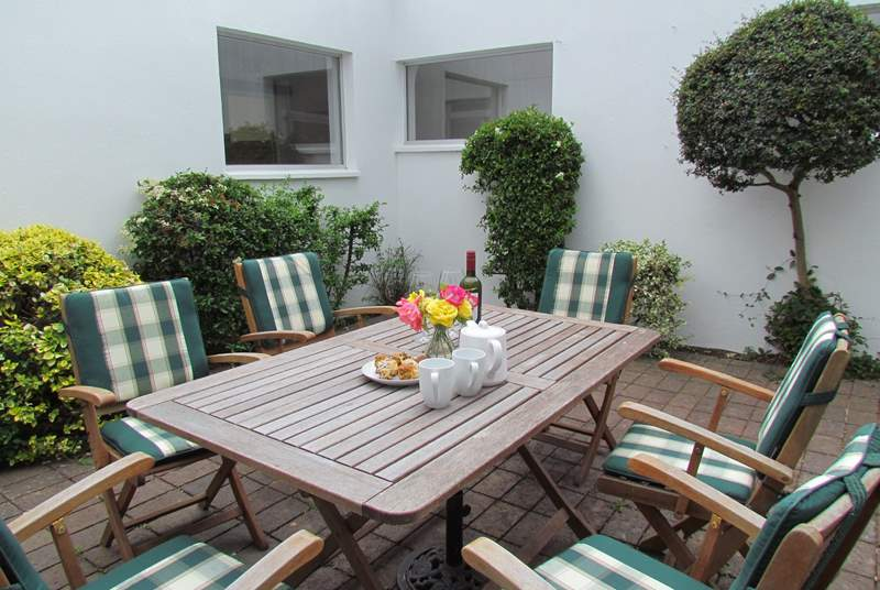 Dining al fresco in this superb internal courtyard is delightful, especially as you can still enjoy the waterside views.