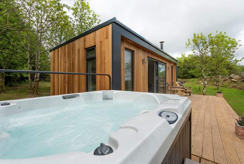 Complete with bubbling hot tub to enjoy the rural bliss from.