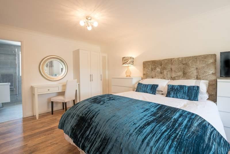 The master bedroom is on the lower ground floor with en suite wet-room.