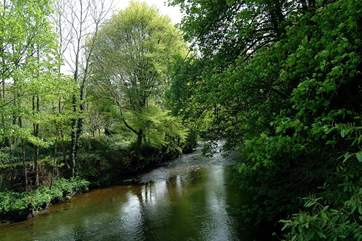 The lane to the cottage is along the edge of the River Lyd.