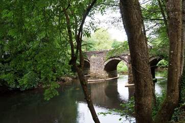 The approach to Little Leat is over the small bridge and down beside the river.