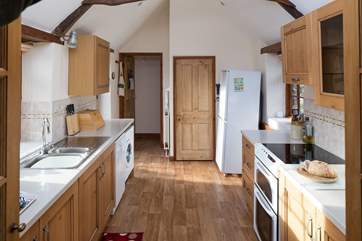 The bathroom is accessed through the kitchen on the ground floor. A snug cloakroom can also be found on the upstairs landing.