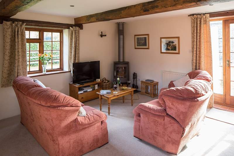 The warming wood-burner is a lovely feature in the sitting/dining-room - ideal after a long walk on the moors.