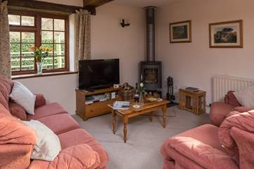 Relax and unwind in the cosy sitting room.