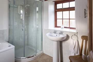 Downstairs bathroom is located to the left of the property on the ground floor.