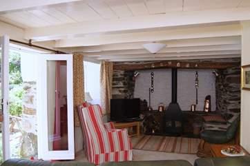 A welcoming wood-burner nestles in the huge inglenook fireplace.