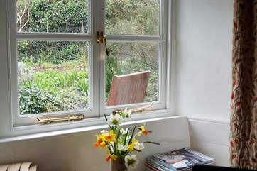 The sitting-room overlooks the pretty cottage garden at the front.