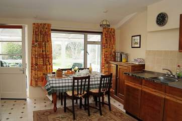 The very well-equipped kitchen leads through to the sunny conservatory.