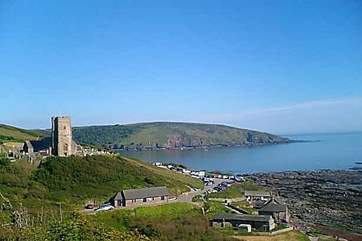 The tower of Wembury church and the coast beyond.