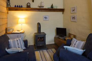 A gas-fired wood-burner style stove keeps this lovely cottage warm and cosy.