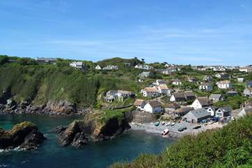 Looking down at Cadgwith from the clifftop coastal path.