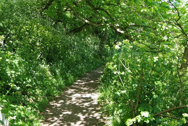 The footpath leads uphill from the village to the car park.
