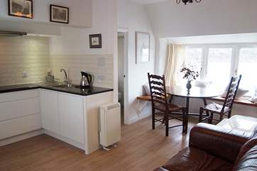 The light and surpisingly spacious open plan living-room with space to cook, eat and relax with the most amazing view.