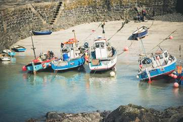 Watch the boats come in and out of this little fishing harbour.