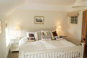 Spacious Bedroom 2 overlooks the cove and the sea beyond, (this bed has two 3ft single mattresses on the 6ft bed frame.)