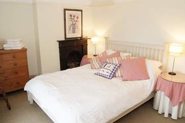 The spacious double bedroom (Bedroom 1) has lovely views out to sea and a 5' double bed.