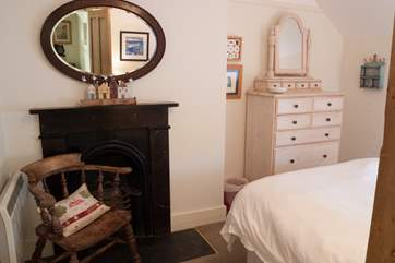 The original fireplace (decoration only) is a lovely feature in this room (Bedroom 3).