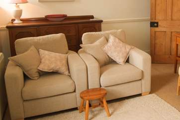 The sitting-room is furnished with a sofa and these two comfy chairs.