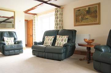 The sofas and armchair are all recliners, perfect for relaxing after a day out exploring.