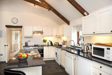 The stylish kitchen painted in Farrow and Ball colours with gorgeous granite worksufaces