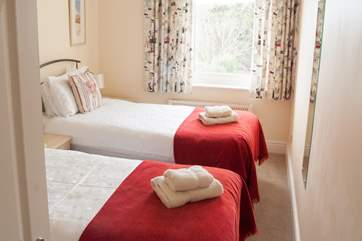 The twin beds in Bedroom 2 are full size singles so suitable for adults or children.